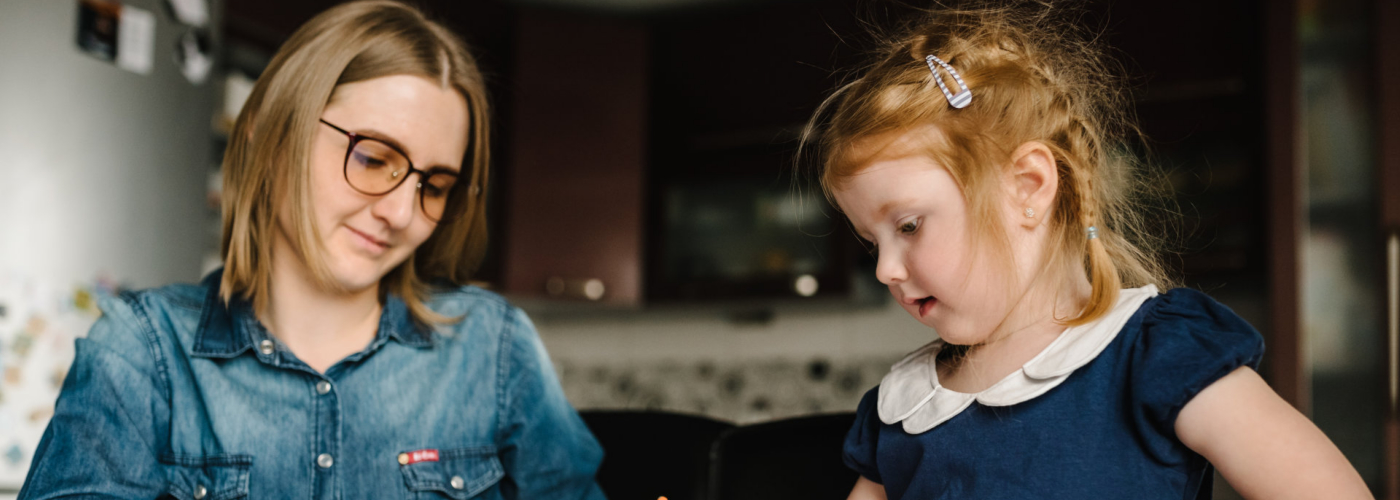 Mother working from home with a kid